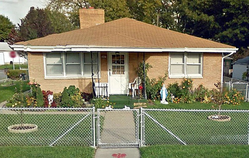 Front yard enclosure (chain link), yard art and religious shrine